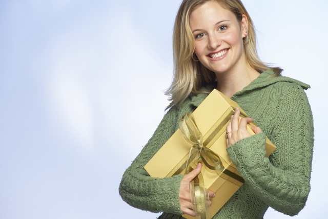 Woman hugging wrapped package